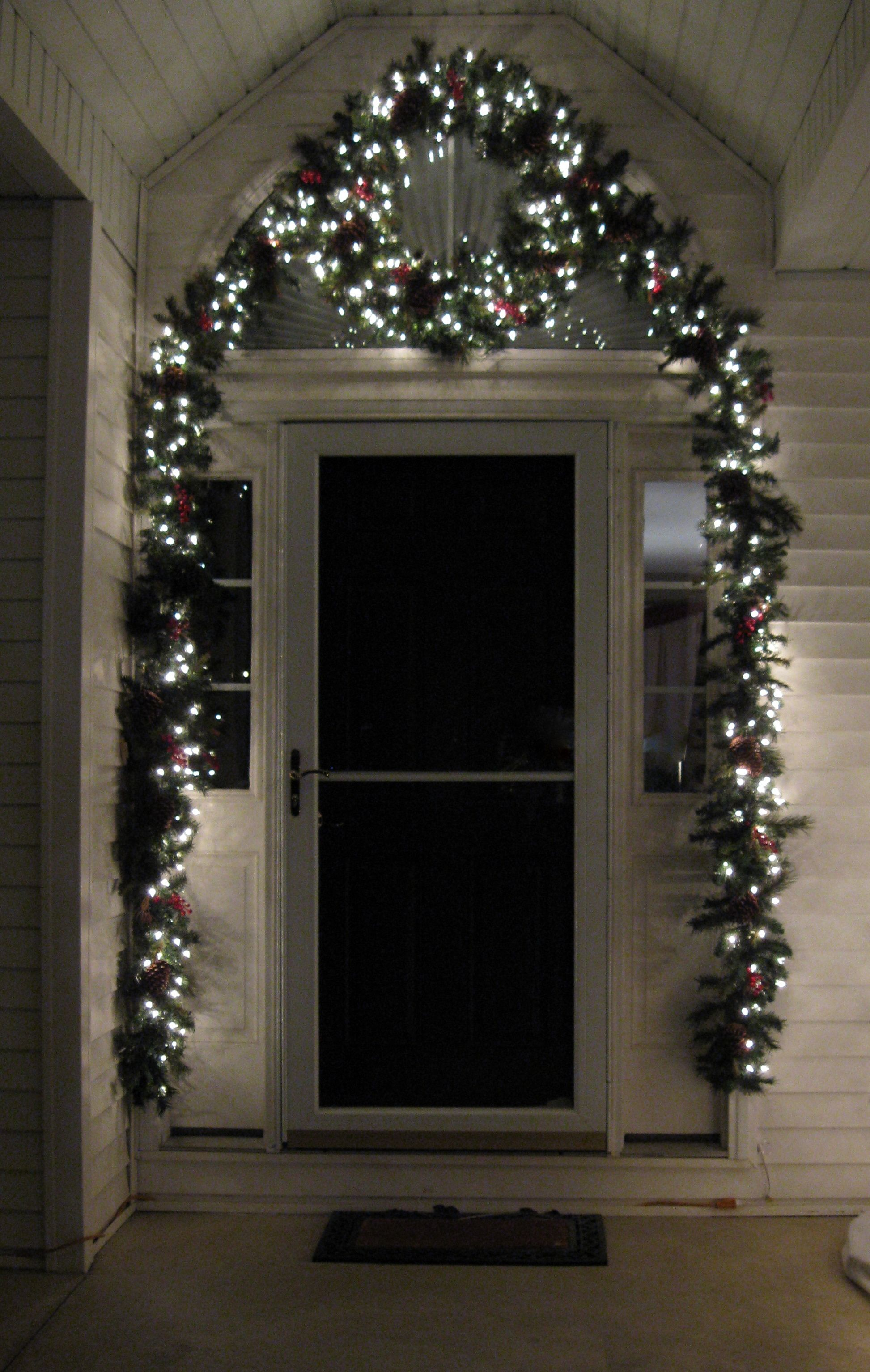Front door christmas lights - Our Front Door Christmas Decorations Garland And A Wreath With Christmas Lights A Very