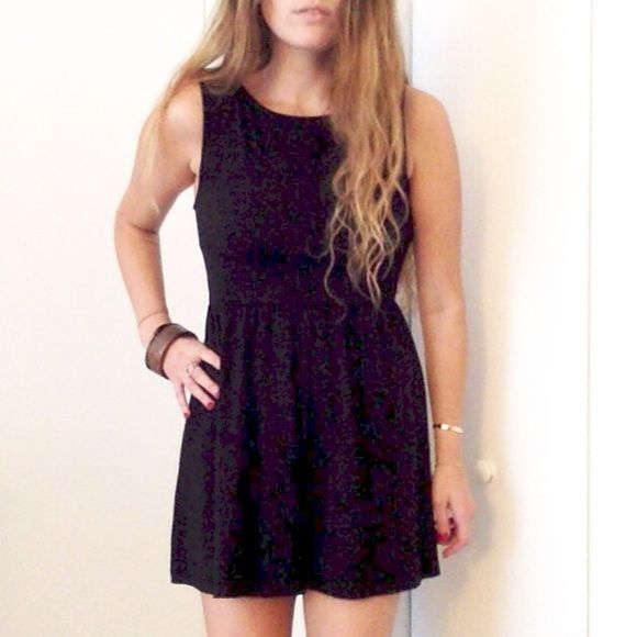 """Little black dress. Unfortunately I cut the tags off years ago because they must have been itchy. But the fit is an XS/small. I'm modeling it even though it's way too short for me ...(I'm 5'7"""")  . Condition is perfect . High neck line makes it perfect for many occasions depending how you style it! Dresses Mini"""