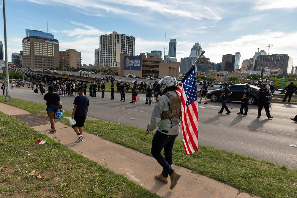 Austin Texas May 30 A Man Wearing A Bullet Proof Vest And Helmet Holds An American Flag As Austi Austin Police Black Lives Matter Protest Bullet Proof Vest