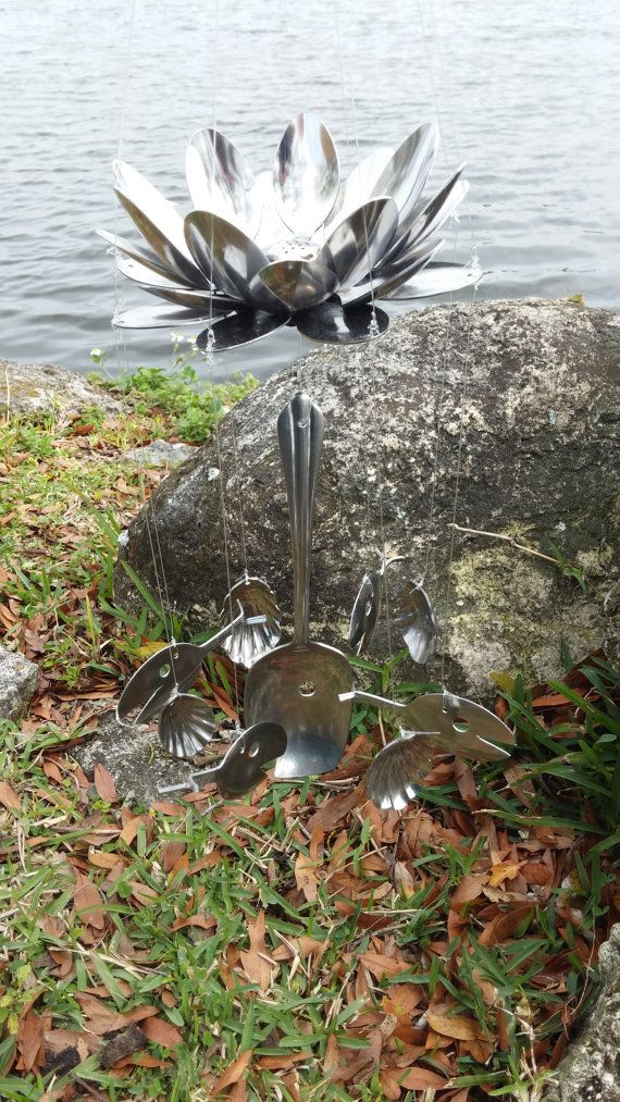 Atop five fish & four shells, this lotus flower gracefully