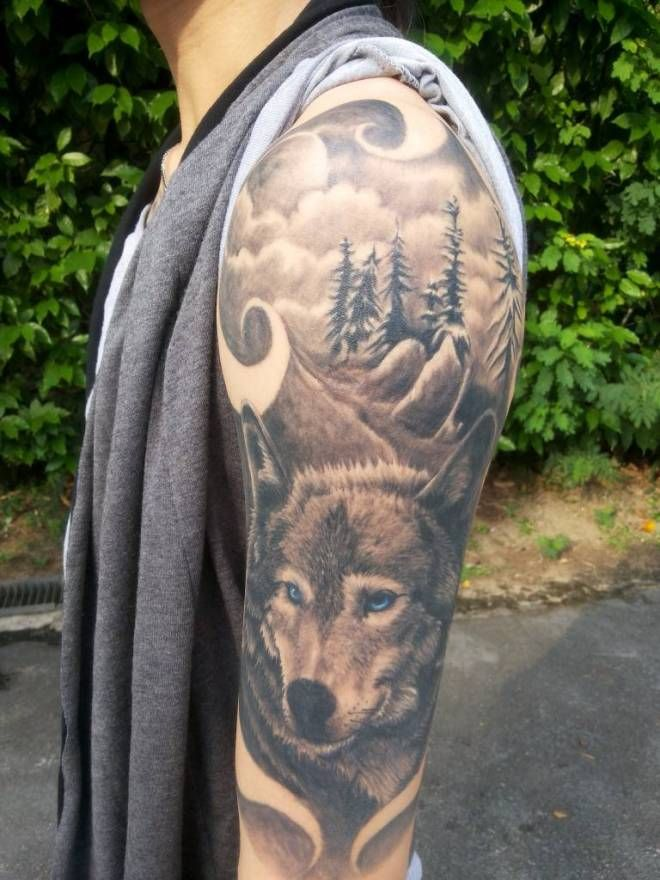Great Tattoo Of A Wolf On His Shoulder