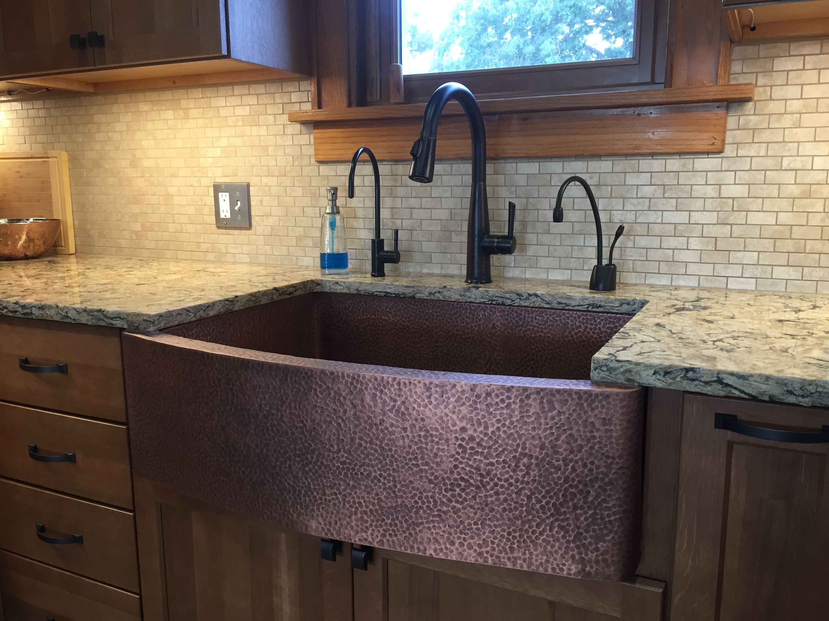 Hammered copper farm house sink with Cambria Bradshaw countertops