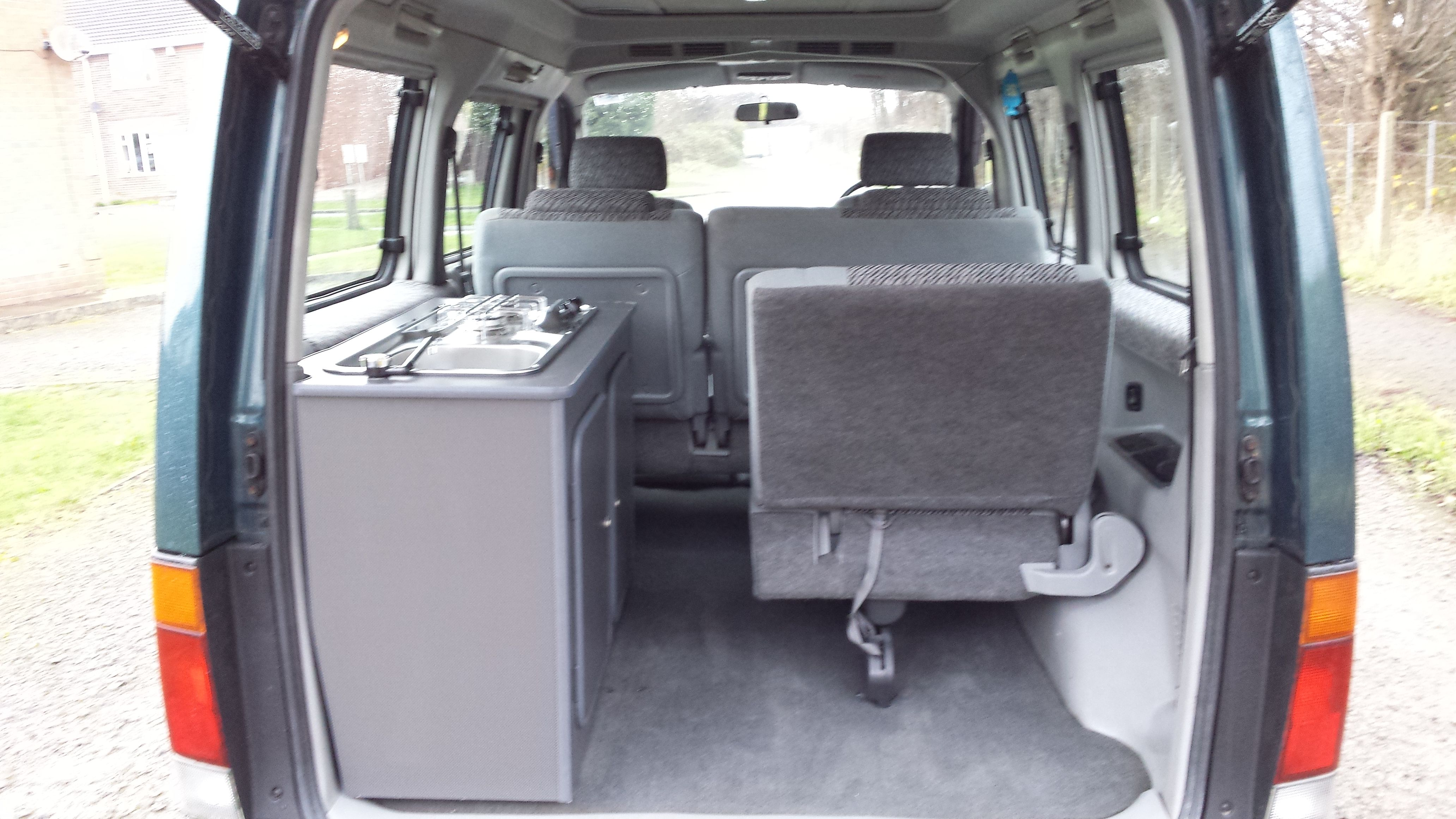 Mazda Bono Camper Van Rear View With Fold Up 6th Seat On Right Carbon Look Kitchen On Left Delica Van Bongo Camper Van For Sale