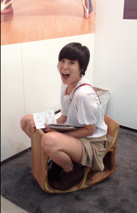 ICFF 2012 (RISD student I met checking out a bench/stool/rocking horse)