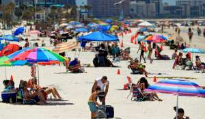 People visit Clearwater Beach after Governor Ron DeSantis