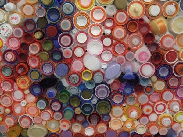 Detail:  Self Portrait by artist Mary Ellen Croteau.  Nestled bottle caps.