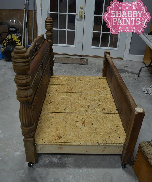 Full size waterfall bed with headboard, footboard, and platform with crib mattress turned pet bed