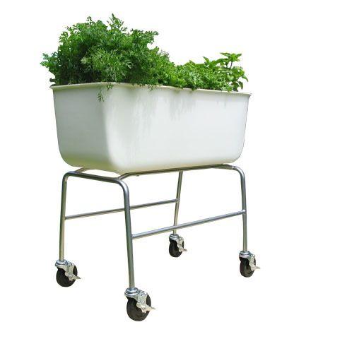 An Edible Garden On Wheels Gardenista Elevated Planter Box Edible Garden Container Gardening