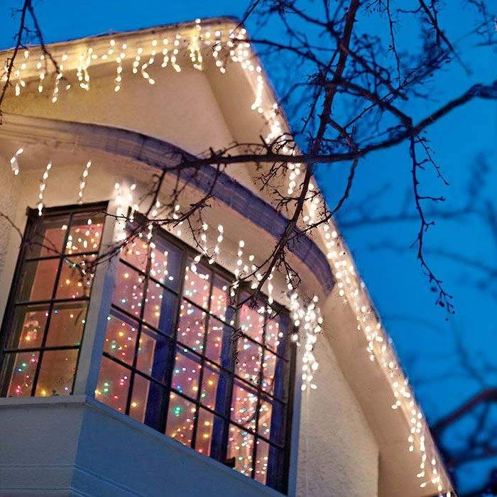 Play Up Your Home S Features Such As A Bay Window With Icicle Lights Hanging Christmas Lights Christmas Lights Outside Christmas Lights
