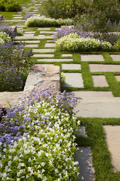 Stepping stones with grass joints from The Good Garden by Edmund ...
