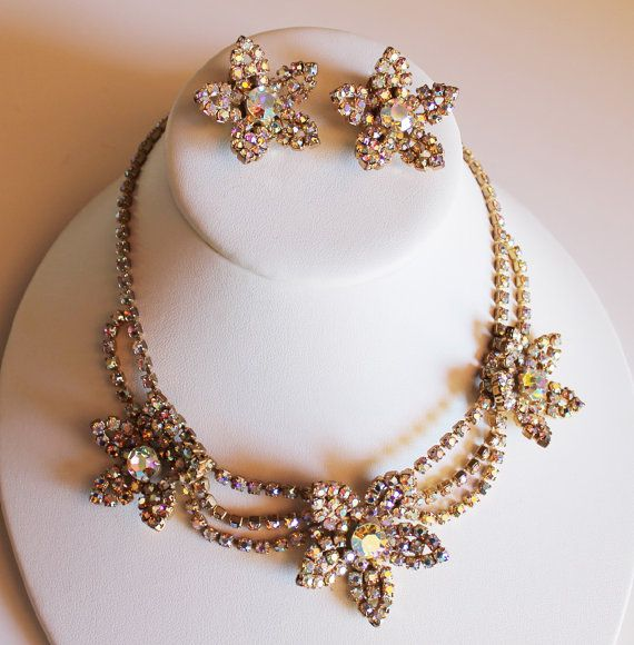 Stunning vintage rhinestone earring and necklace set with floral star design. Please. I adore this. $88