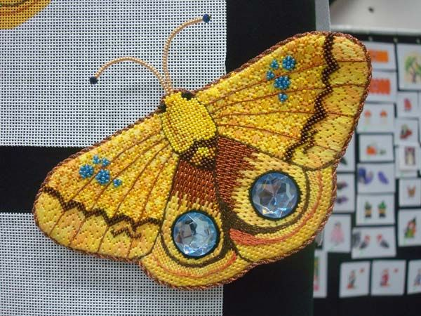 Metallic threads, silk threads, cabochons and beads combine to make a stunningly gorgeous stitched butterfly.