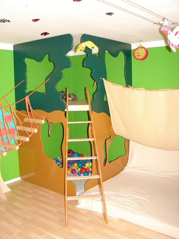 A playroom with an indoor treehouse, swinging bridge and climbing ...