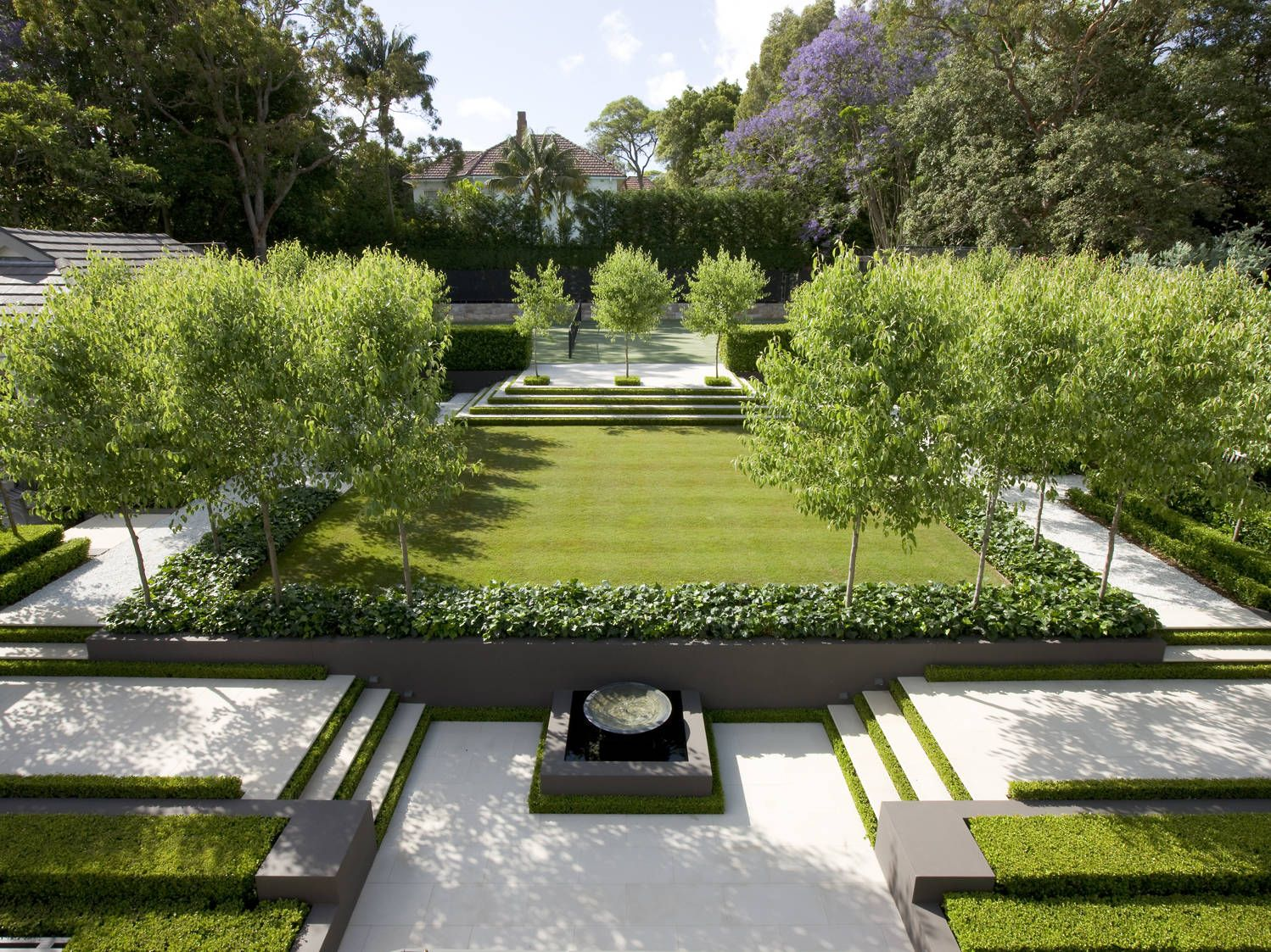 In This Contemporary Formal Garden Shaded By Pear Trees