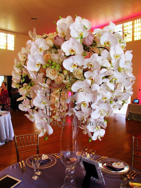White Roses and White Orchids Centerpiece