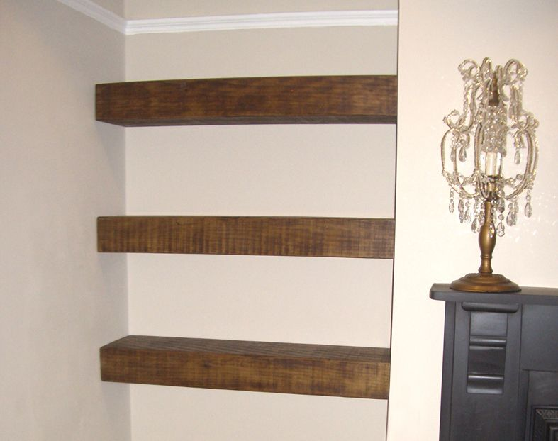 rustic floating shelf next to fireplace TV and fireplace