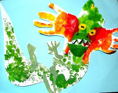 Another handprint dragon for Chinese New Year - this one uses a foot and two hands for the head, along with a snout made out of an egg carton cup.