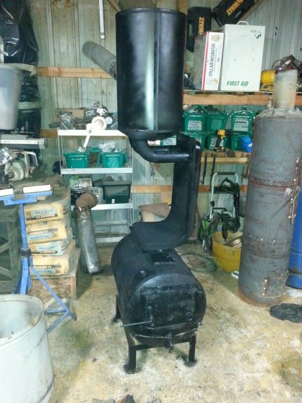 Homemade wood burning stove made from an old water heater tank and a gas  furnace heat - Homemade Wood Burning Stove Made From An Old Water Heater Tank And