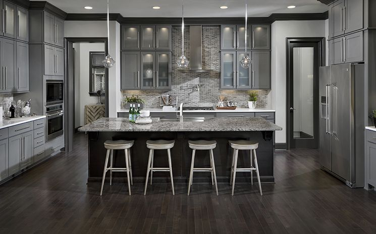 This Gourmet Kitchen Features A Center Island With Seating A Walk In Pantry And Offers Access
