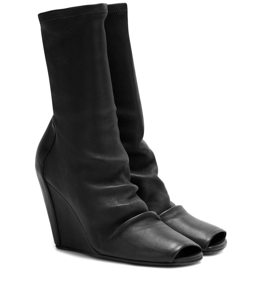 Rick Owens - Peep-toe leather wedge boots - With his extraordinary cult following, Rick Owens is the king of avant-garde. We love the way these coolly unique leather boots glide over the ankle to fit like a second skin. Let them ground a draped dress. seen @ www.mytheresa.com