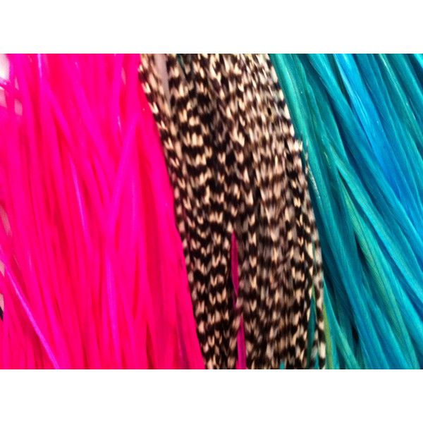 Slender feather hair extensions with fun hand dyed colors that pop. Turquoise blue, hot pink, and natural grizzly feathers. These are salon grade, soft and flo…