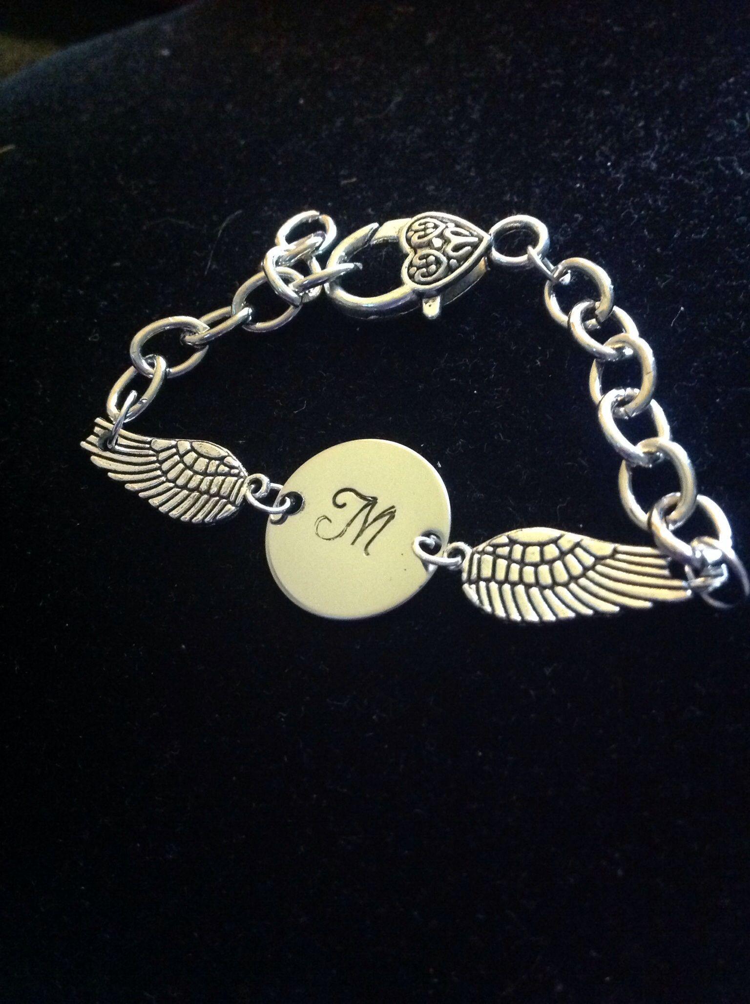 Beautiful wing and initial bracelet.  So elegant on. Stampedbyjodi.storenvy.com