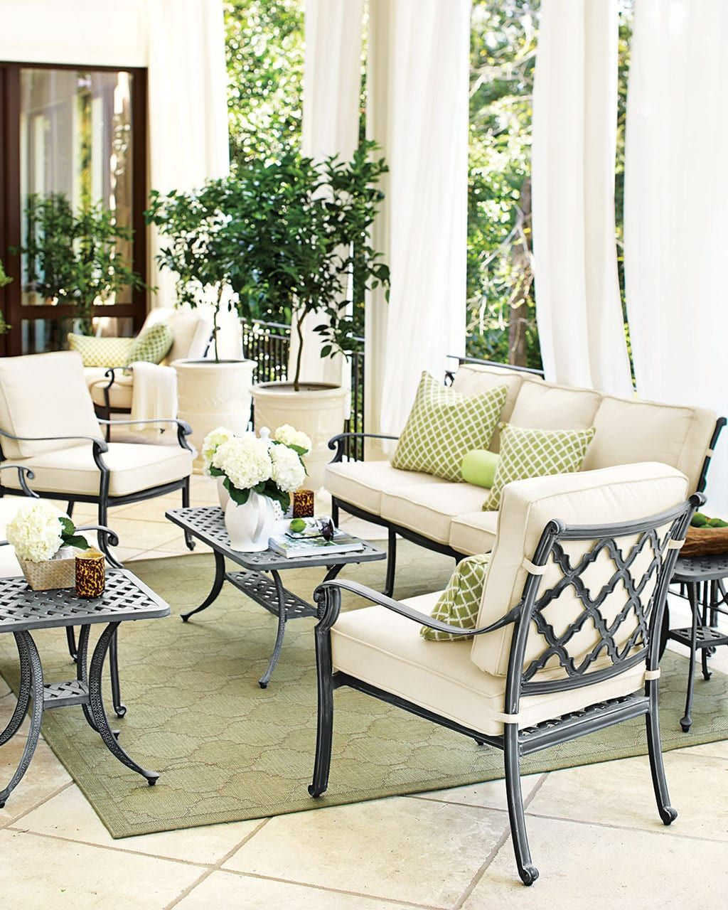 Covered patio with white outdoor curtains and aluminum furniture ballard designs