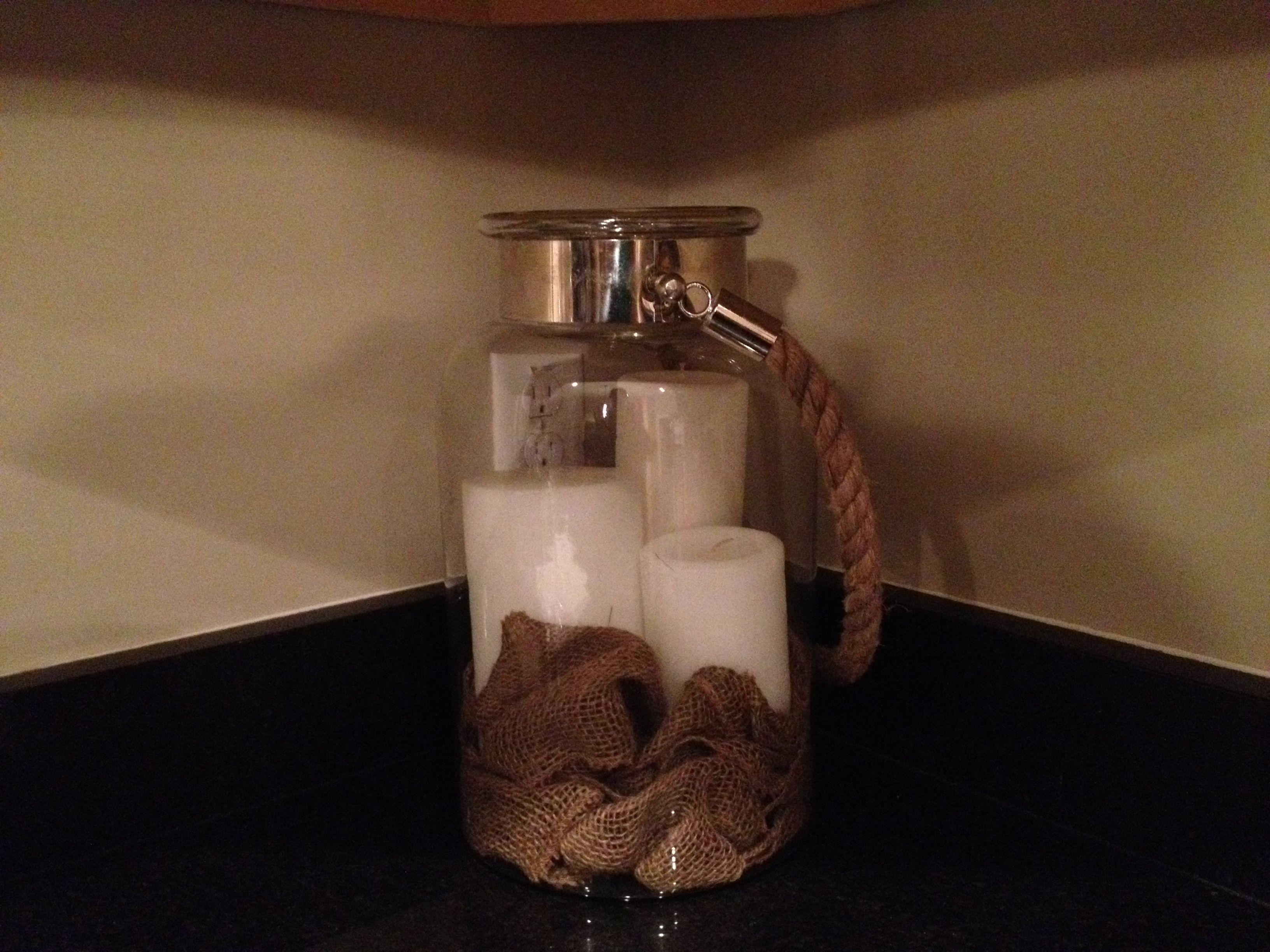 Burlap used in the base of a jar with candles