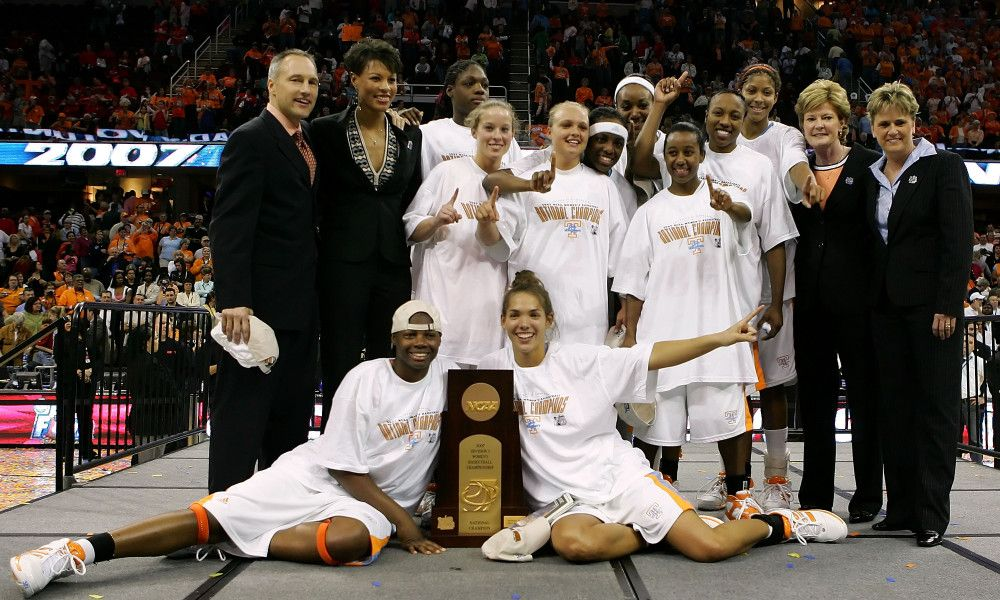 CLEVELAND - APRIL 03:  The Tennessee Lady Volunteers pose for a team photo with the trophy after their 59-46 victory against the Rutgers Scarlet Knights to win the 2007 NCAA Women's Basketball Championship Game at Quicken Loans Arena on April 3, 2007 in Cleveland, Ohio.  (Photo by Jim McIsaac/Getty Images) *** Local Caption *** Pat Summitt;Candace Parker;Sidney Spencer;Shannon Bobbitt ORG XMIT: 73703984 GTY ID: 03984CC049_NCAA_Women_s_
