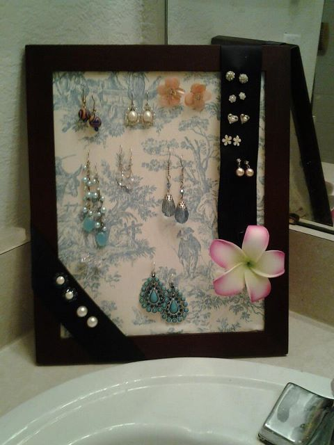 Picture frame. Remove glass and backing. Hot glue/rubber cement in place of glass. Hot glue ribbon for added storage. SO EASY and SO CHEAP! :)