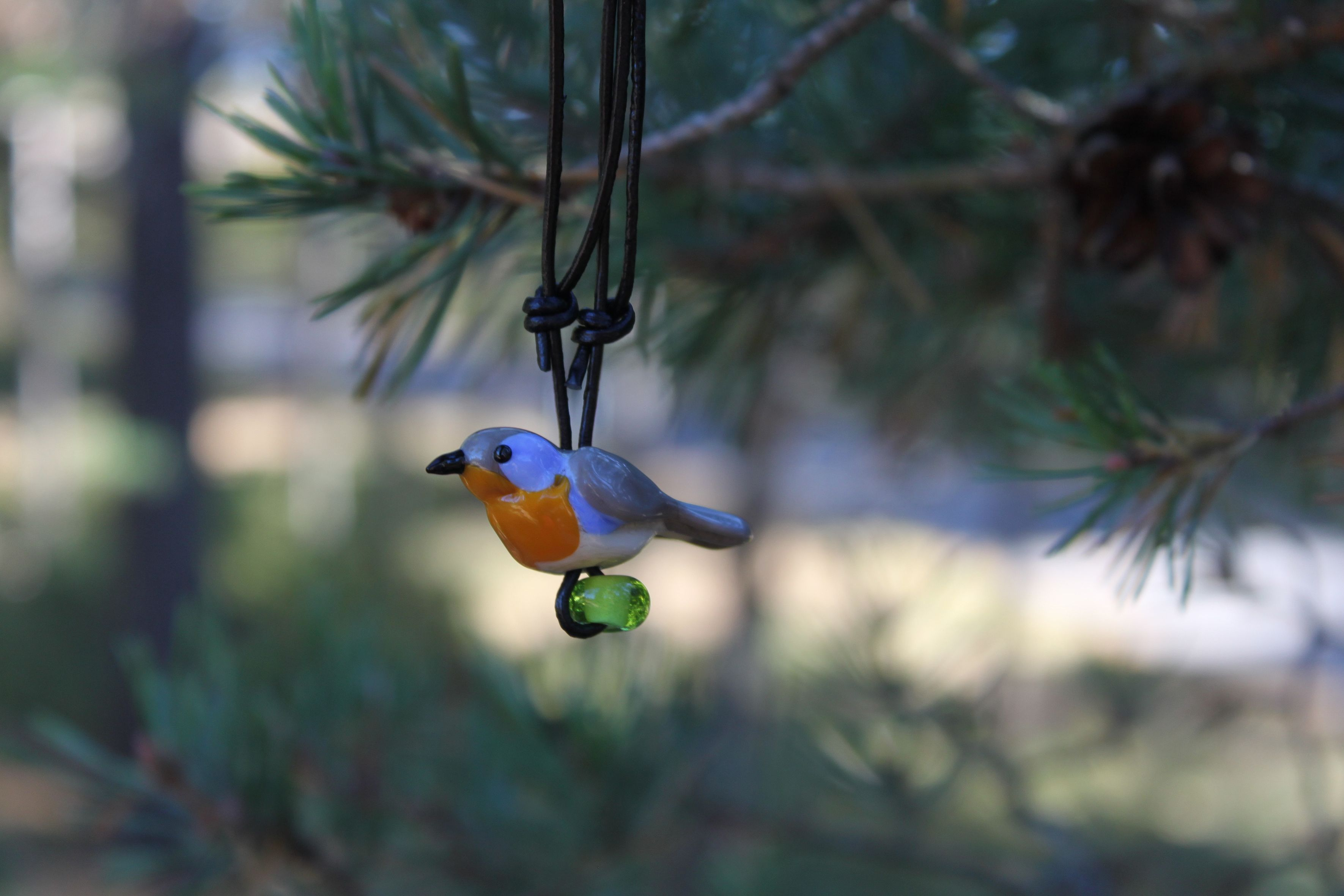 """The Robin is in Finnish """"punarinta"""". This small glass sculpture bird is made by Marja Hepo-aho."""