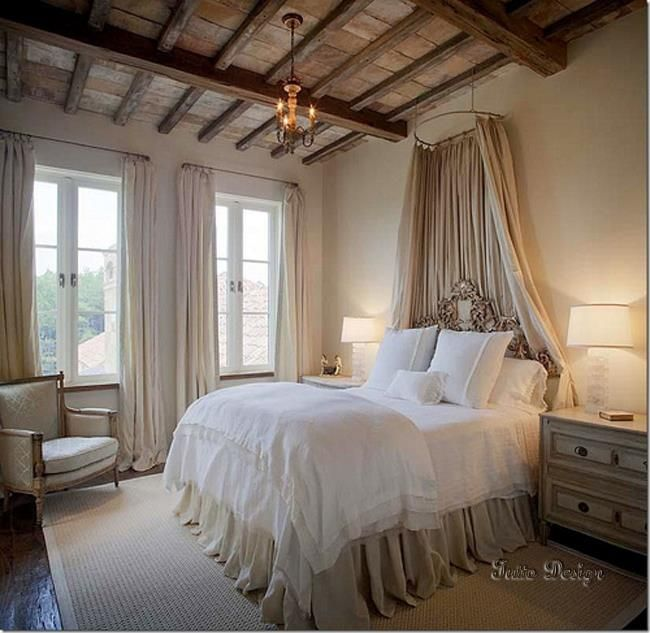 I love the curtain over the bed! and the drapes on the windows