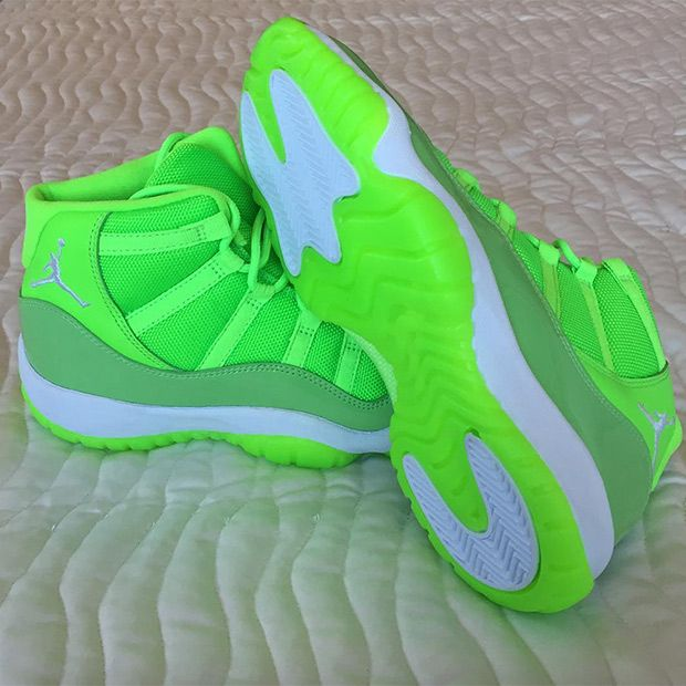 bd76ac320dad USA track star Kori Carter received an exclusive Neon Green Air Jordan 11  PE as a gift right before the Olympics. The bright pair won t release at  retail