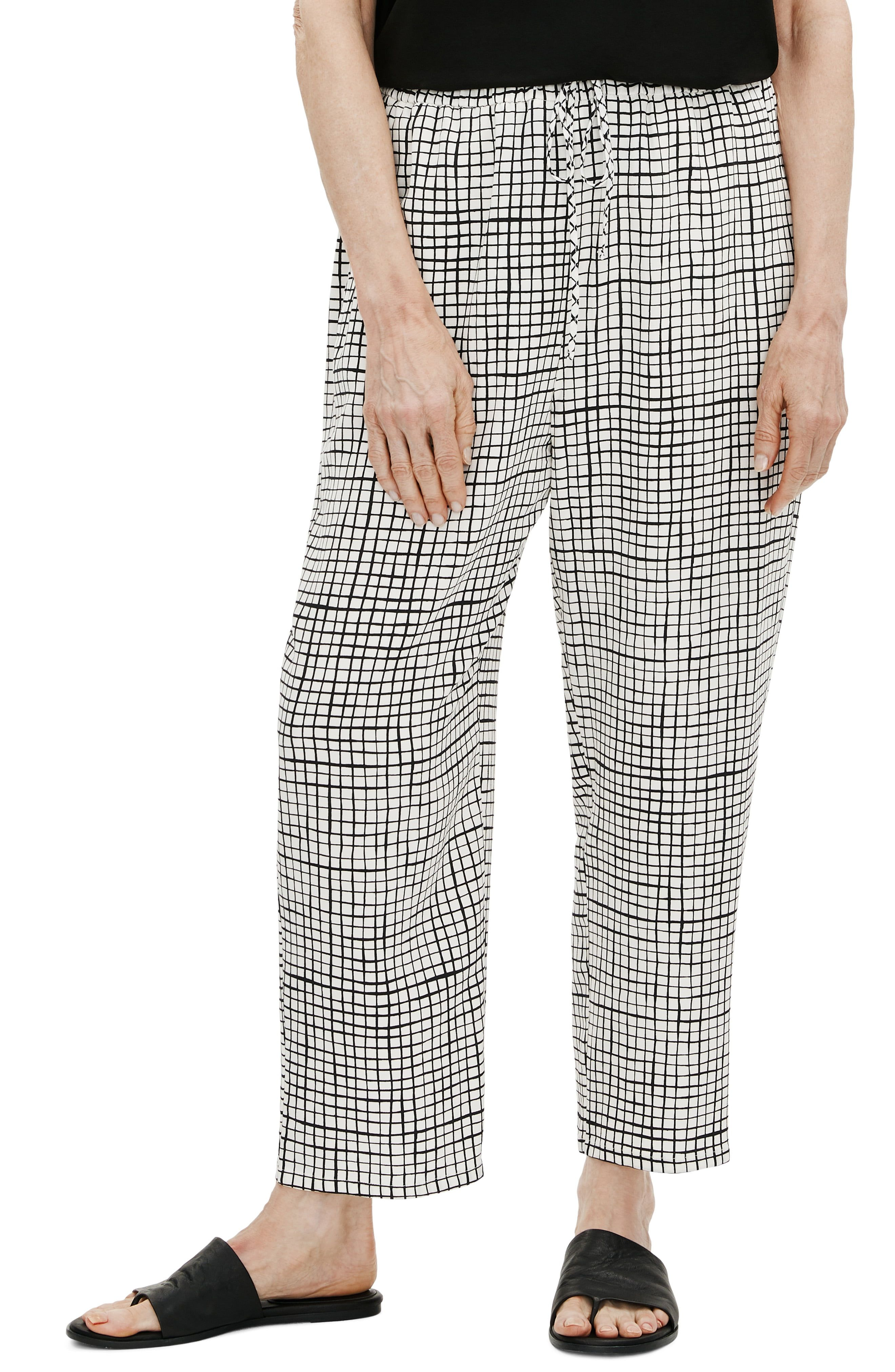 Easy and comfortable drawstring-waist pants crafted of an organic-cotton blend get a chic update with hand-sketched windowpane checks. Style Name:Eileen Fisher Check Slouchy Crop Pants (Regular & Petite). Style Number: 6074328_1. Available in stores.