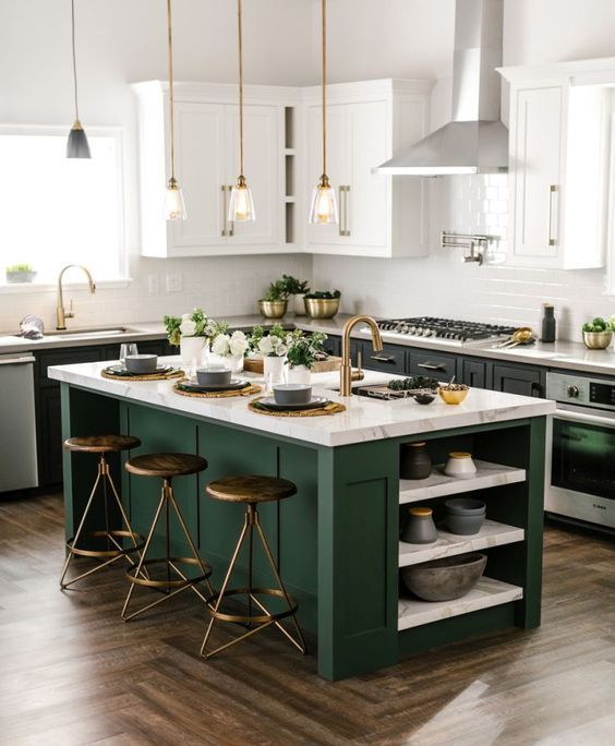 A Black And White Kitchen With A Dark Green Kitchen Island