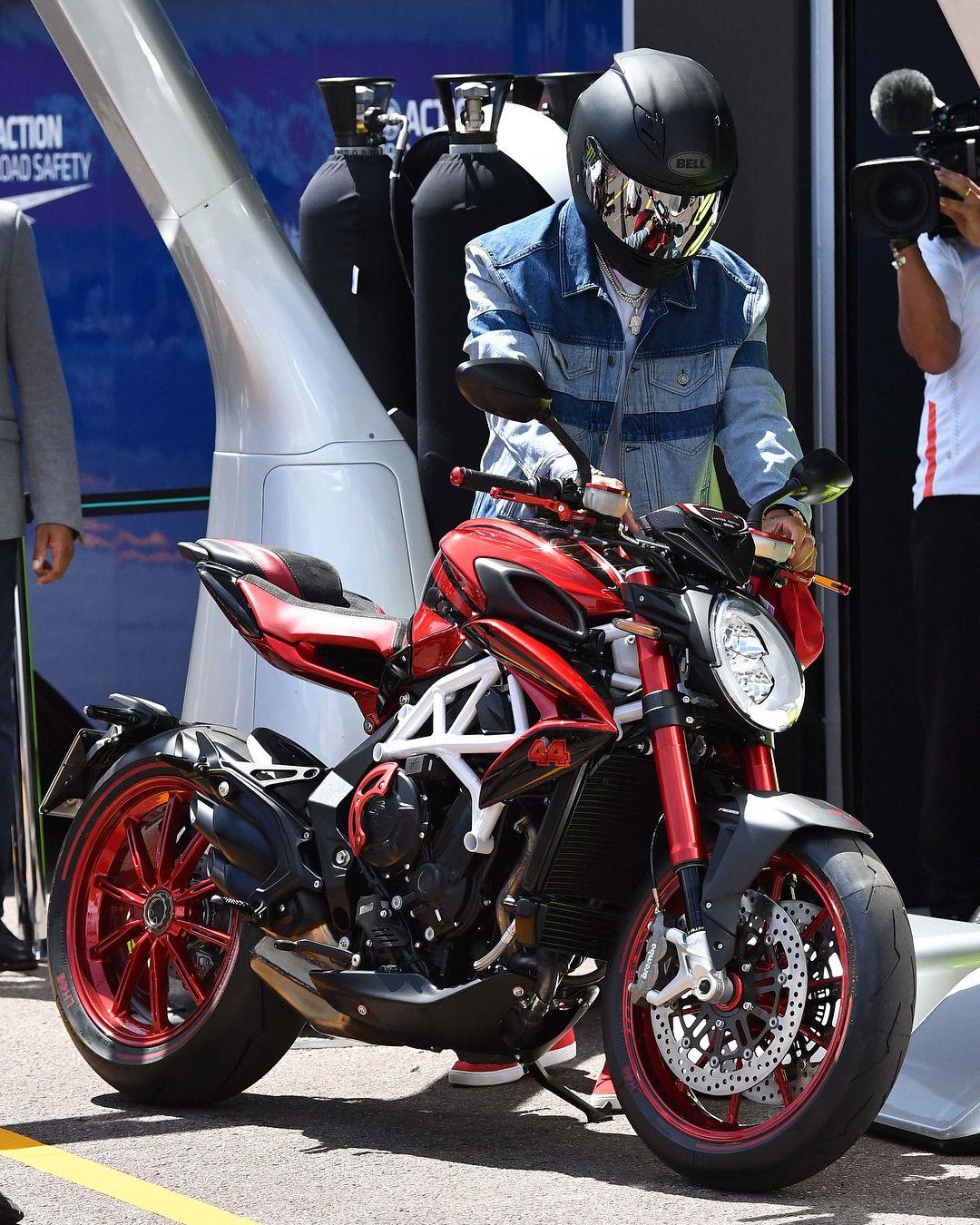 Lewis Hamilton Arrives On His Mv Agusta Motorbike In Monaco F1