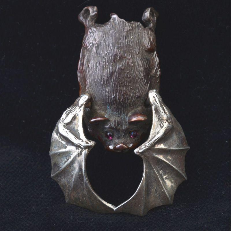 Robert Burkett: sterling silver and shibuichi bat pendant