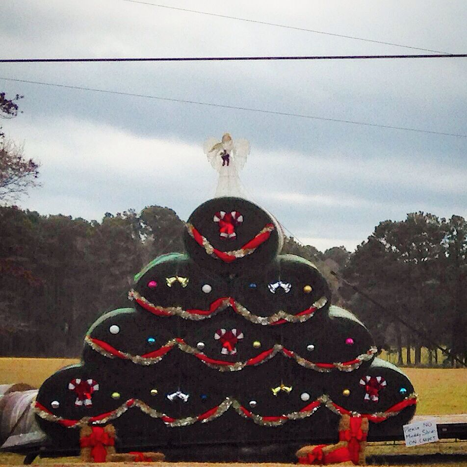 Christmas tree made of round hay bale.