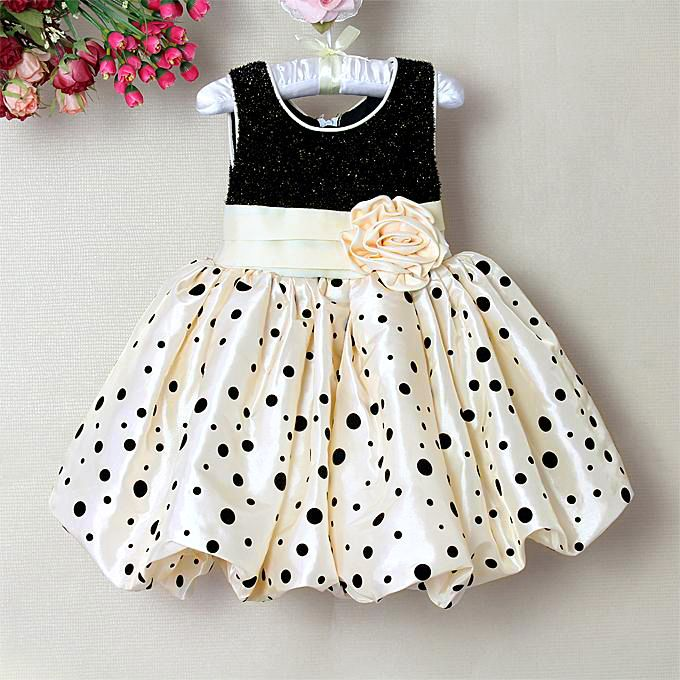 8df9b383a4117 online shopping in India for the designer little princess dress in shimmery  black and cream combination.