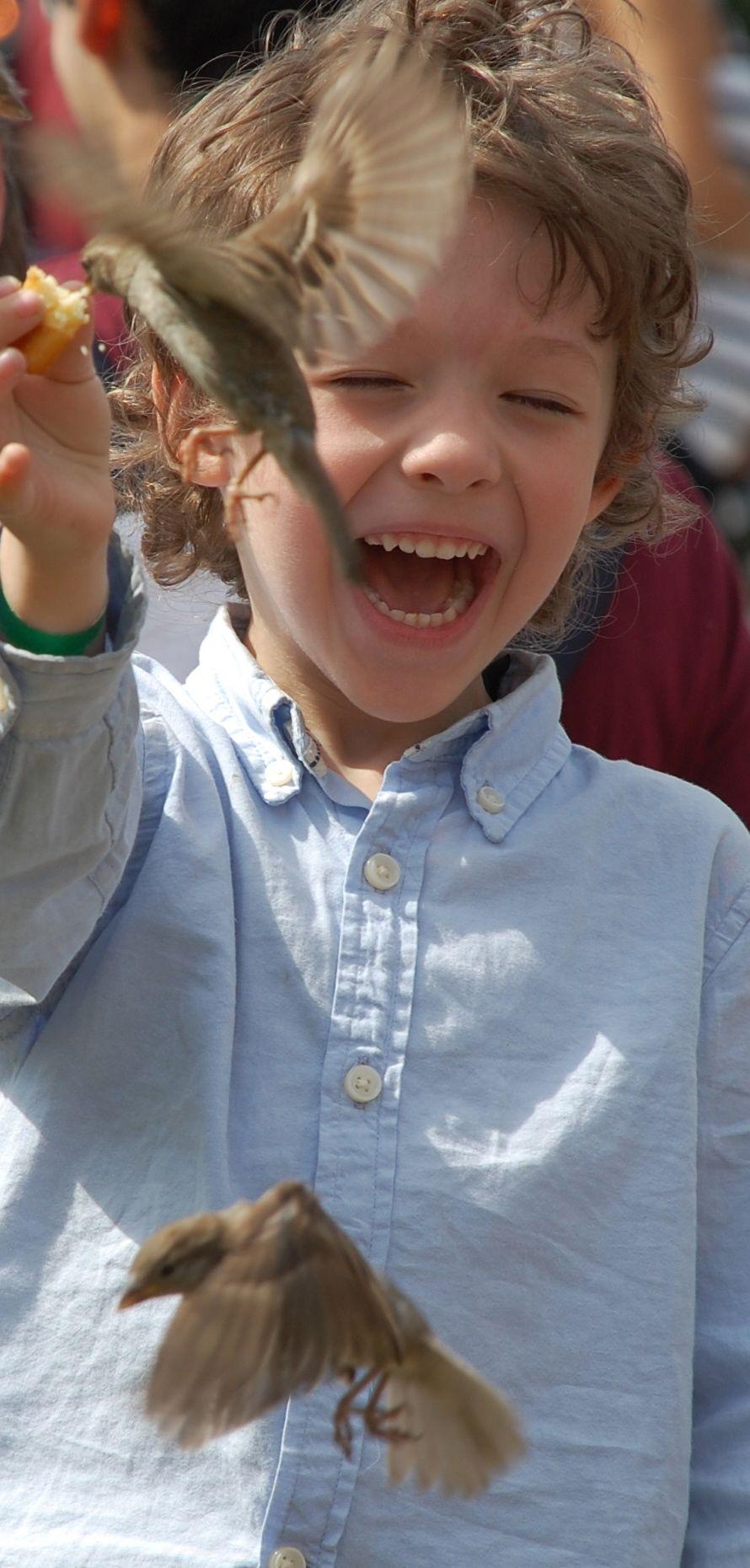taken outside Notre Dame...Paris, France...children, bird, happy,