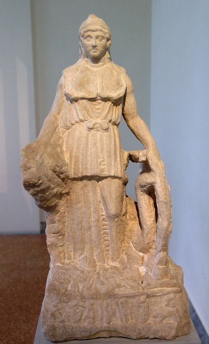 """Statuette of Athena. Pentelic marble. Found in Athens, near the Pnyx.  Known as the """"Lenormant Athena"""", this statuette copies the Athena  Parthenos by Pheidias. Although unfinished, the work is important  because it preserves the relief representation of an Amazonomachy on the  exterior of the shield and the relief image of the Birth of Pandora on  the base — themes that adorned the original statue of Athena. The Roman copy  probably dates to the 1st century AD."""