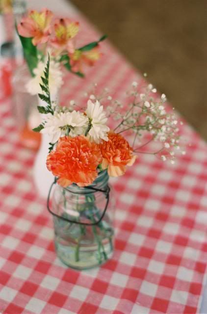 We created the arrangements at a floral warehouse. Super cheap!