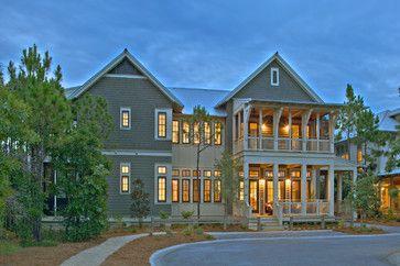 Dark windows, cream trim, green siding. Alford Residence
