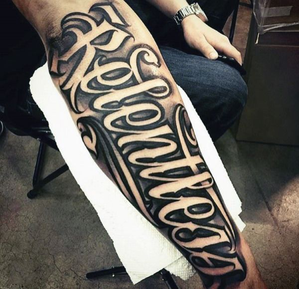 Mens Relentless Script Tattoo On Outer Forearm With Neagtive Space ...