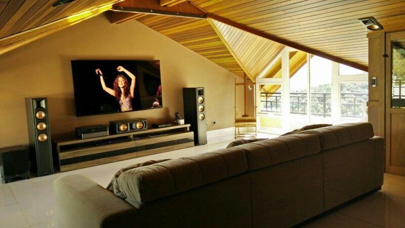 Our Home theater... (sótão com lambril de madeira no teto)