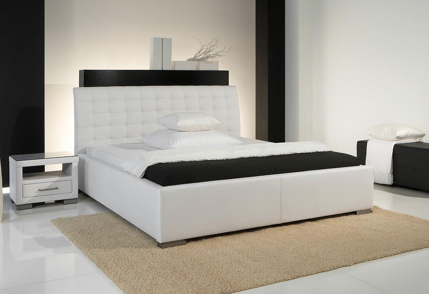 Polsterbett mit Kunstlederbezug. Farben schwarz, weiß