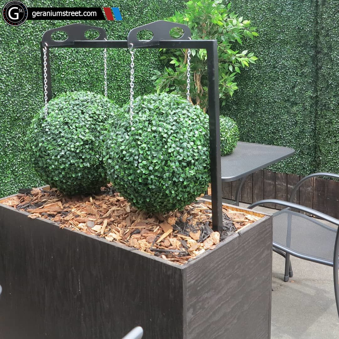 What A Wonderful Use Of Our Artificial Topiary Balls This Patio Got Just The Touch Of Scenery It Need Artificial Topiary Artificial Boxwood Artificial Plants