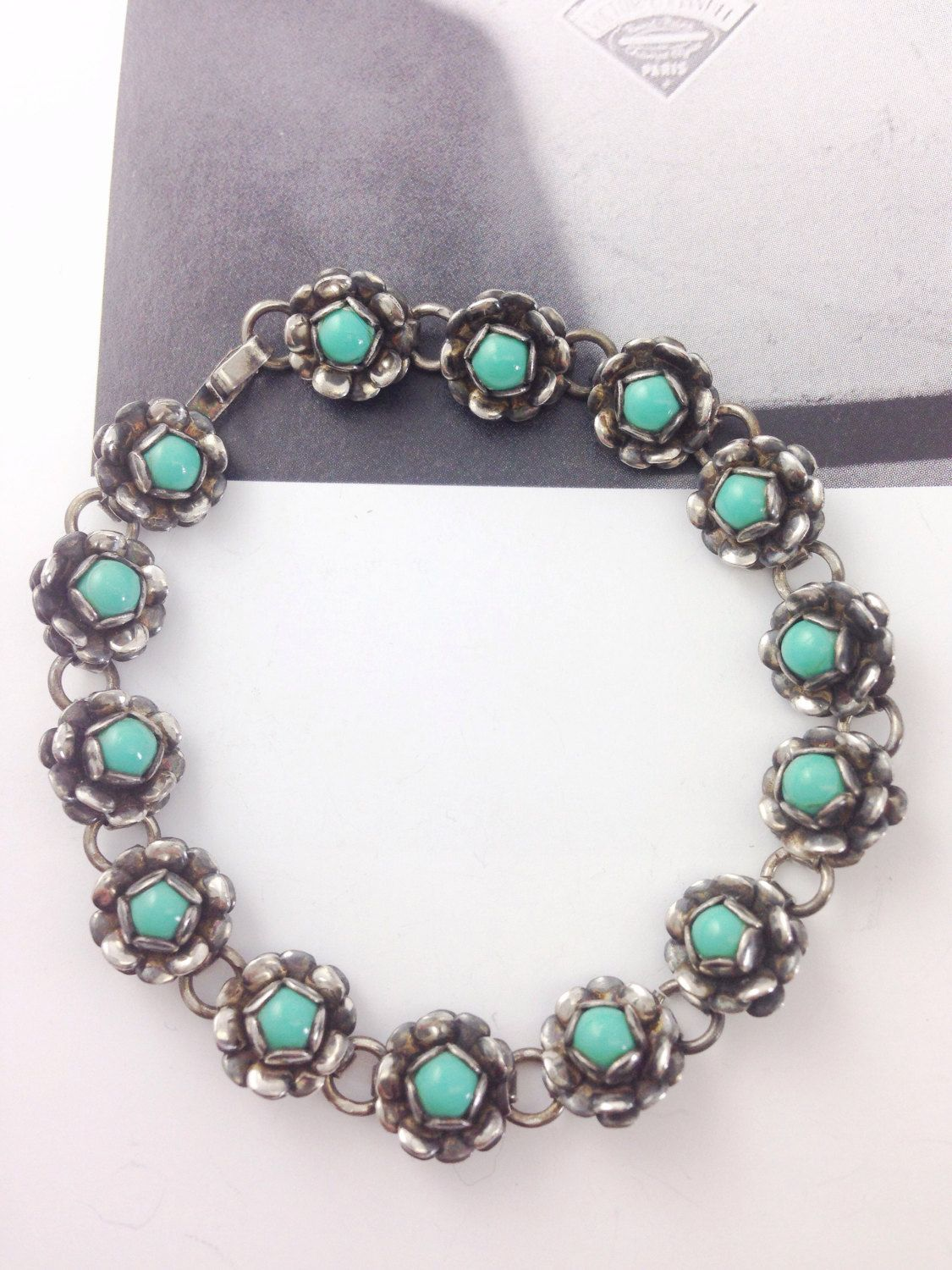 Isn't this perfect for summer? Mexican silver and turquoise flower bracelet from my Etsy shop https://www.etsy.com/listing/453400276/vintage-mexican-sterling-silver-flower