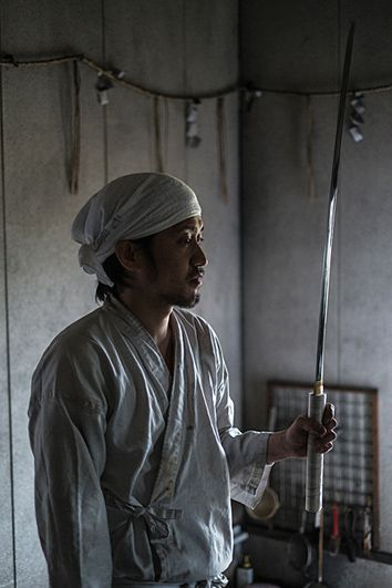 Master checking Katana. Soon the sword will be ready to be polished.