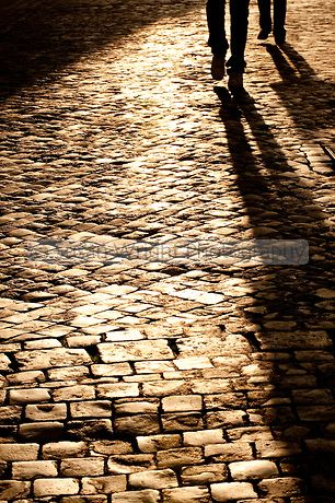 Cobble-stoned footpath, in the historic district of Monti, Rome, Italy